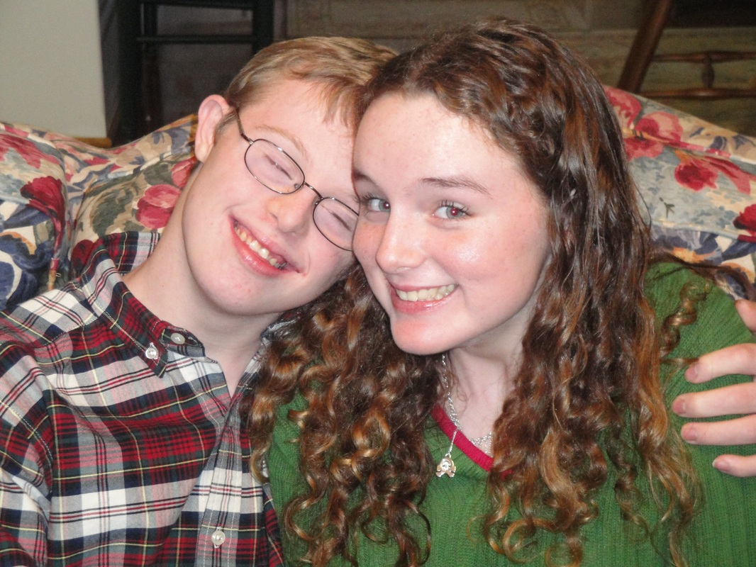 Rion Holcombe, an adult who has Down syndrome, with his sister on The Road We've Shared