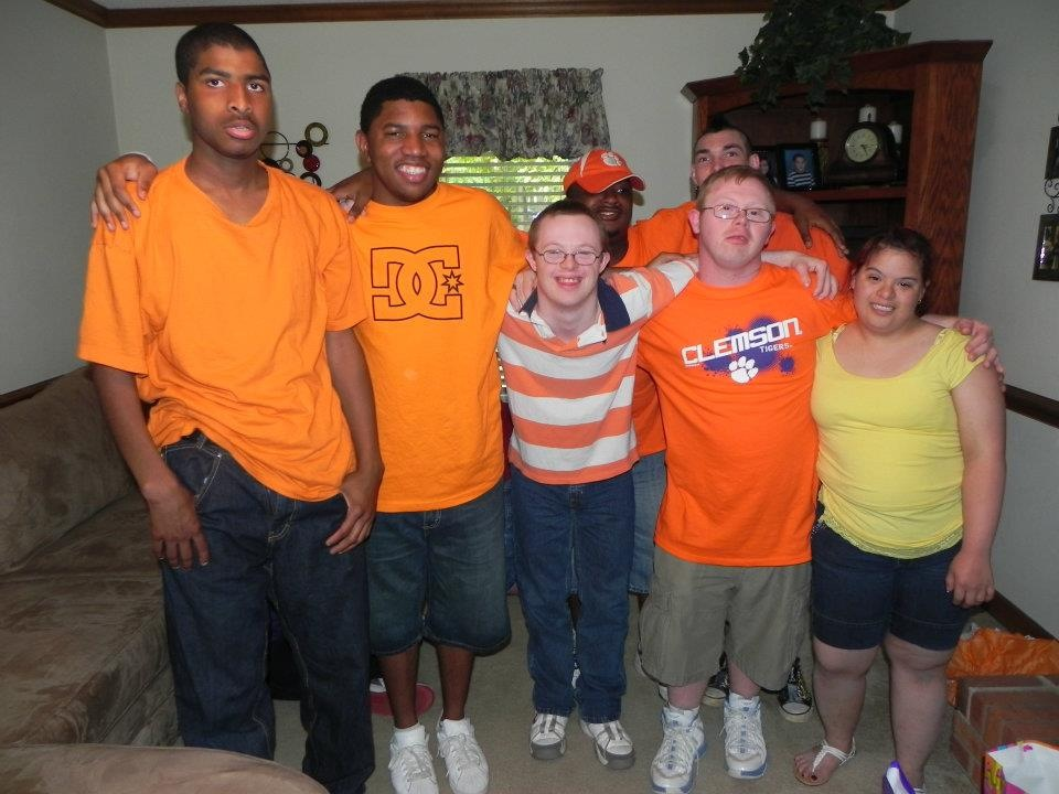 Rion Holcombe, an adult who has Down syndrome, with his friends on The Road We've Shared